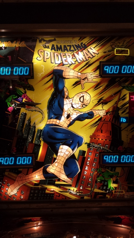Detail from a pinball machine showing Spider-man